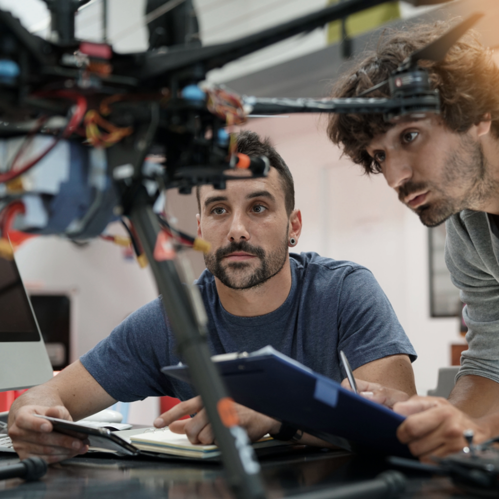 Two Engineers working on mobile robotic platforms